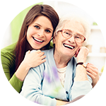 Caretaker having a conversation with a senior living resident at Storey Oaks of Oklahoma City