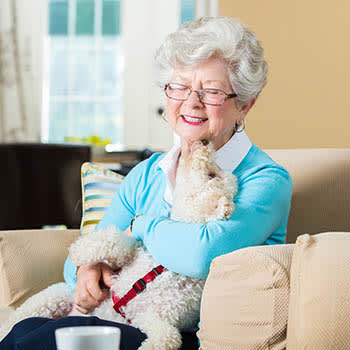 Senior woman with her dog at Victory Centre of Bartlett
