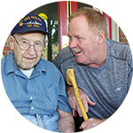 Caretaker having a conversation with a senior living resident at West Fork Village in Irving, Texas