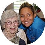 A caretaker with senior resident at West Fork Village in Irving, Texas
