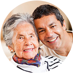 A resident and caregiver laugh together at Wyndham Court of Plano in Plano, Texas