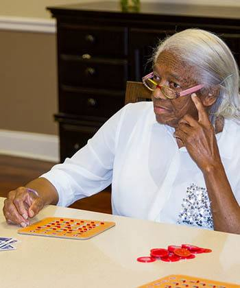Resident playing bingo at The Phoenix at Johnson Ferry in Marietta, GA