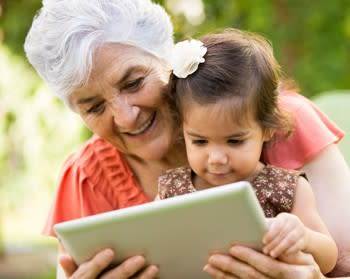 Family support is key, woman reading to child