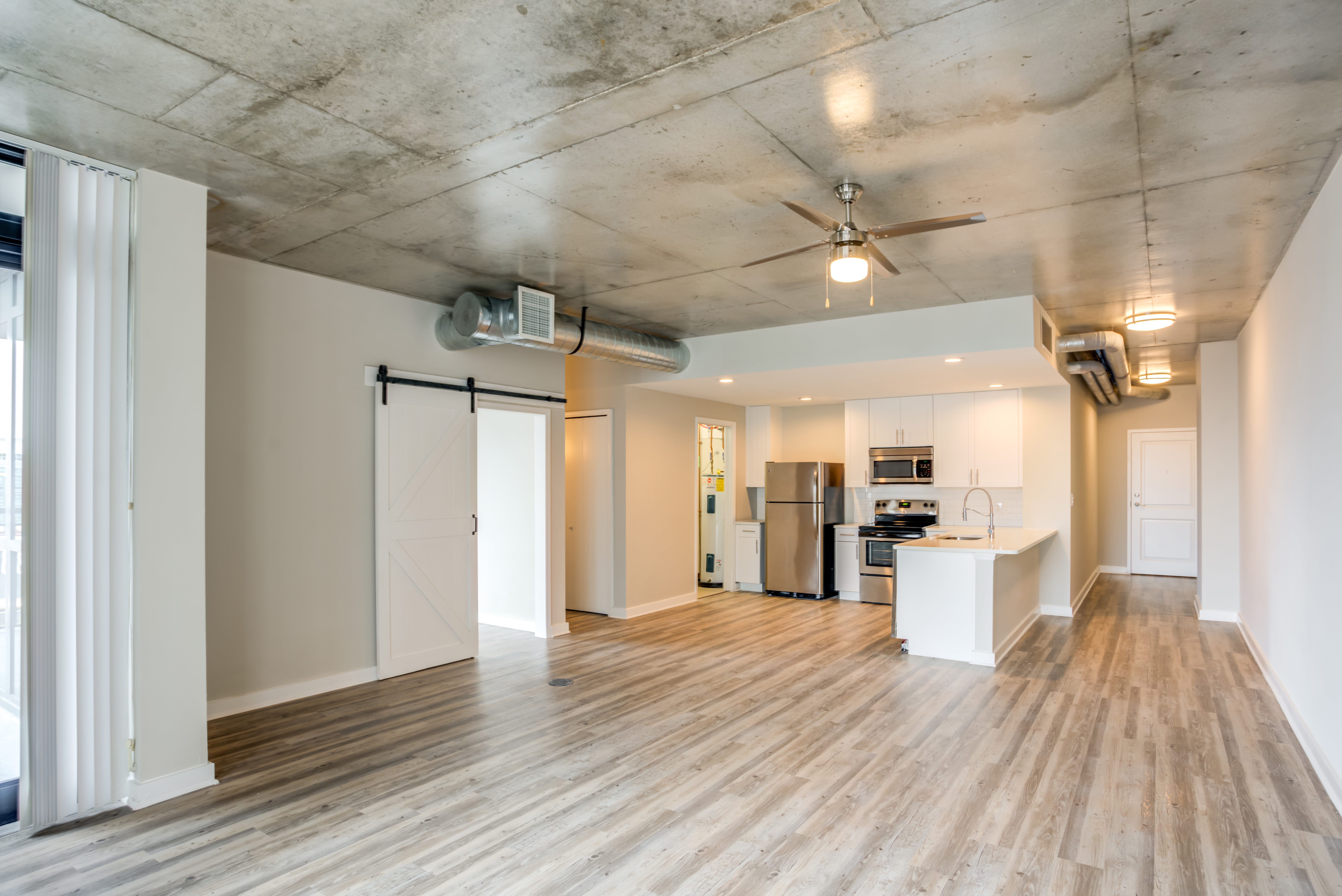 Spacious living room with hardwood floors and amazing views of city at 55 West Apartments in Orlando, Florida