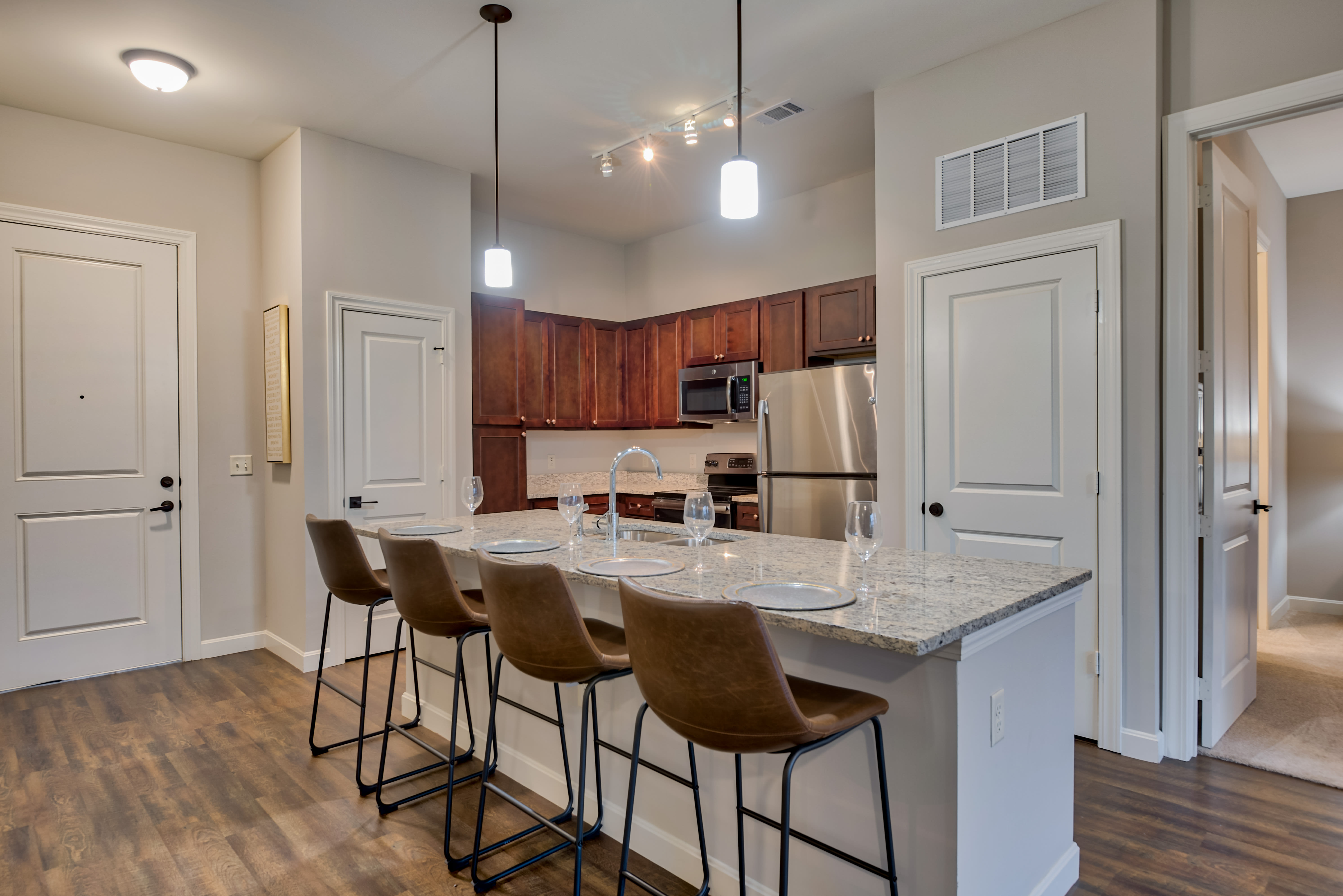 Granite counter tops with stainless steel appliances in the kitchen at Boulders at Overland Park Apartments in Overland Park, Kansas