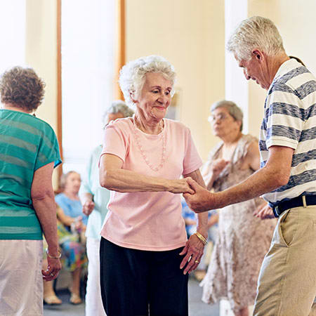 Residents dancing together at The Legacy at Southpointe Drive in Greenville, South Carolina