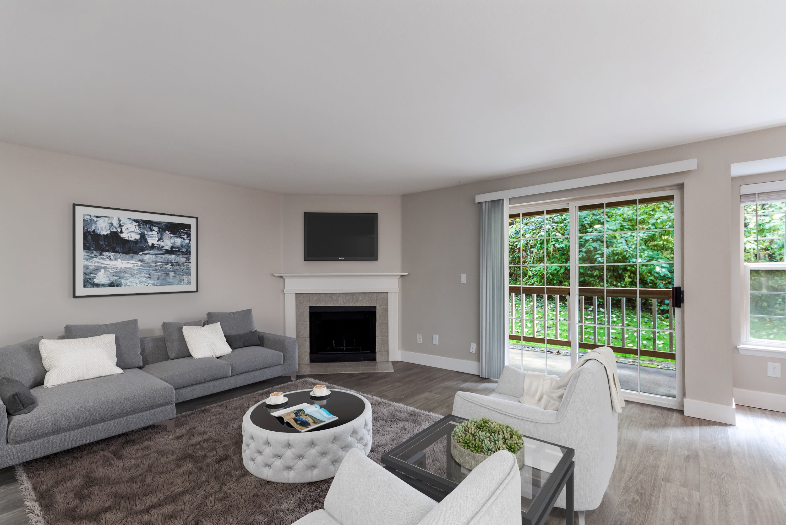 Fireplace and hardwood floors in model apartment home at Chandlers Bay