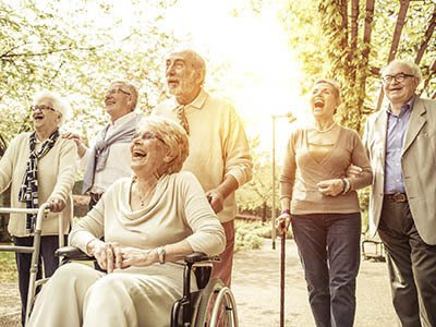 Residents out for a walk on a beautiful day at Oak Ridge Alzheimer's Special Care Center in Haltom City, Texas