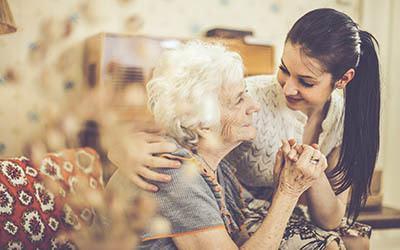 Resident spending time with her granddaughter at Oak Ridge Alzheimer's Special Care Center in Haltom City, Texas