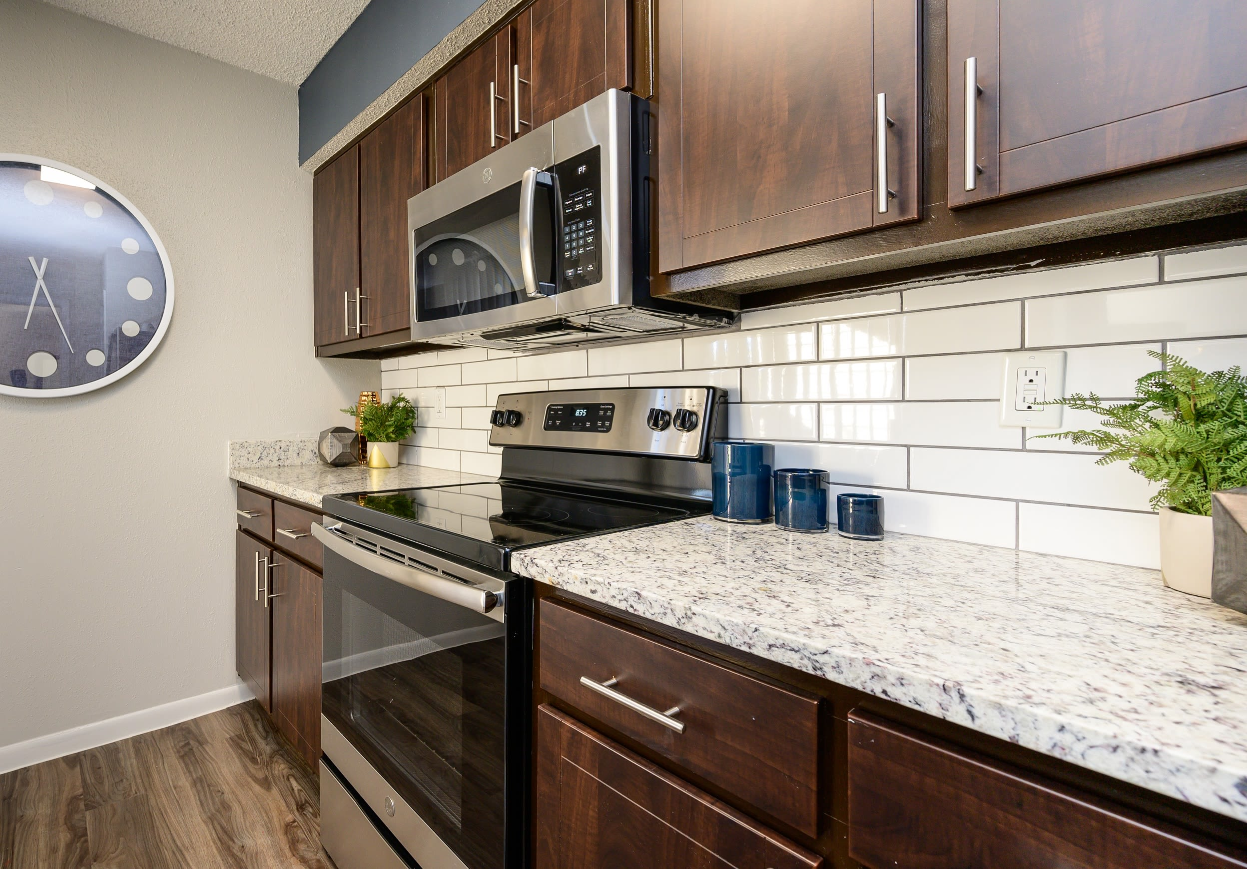 Kitchen with wood cabinetry at Laurel Heights at Cityview in Fort Worth, Texas