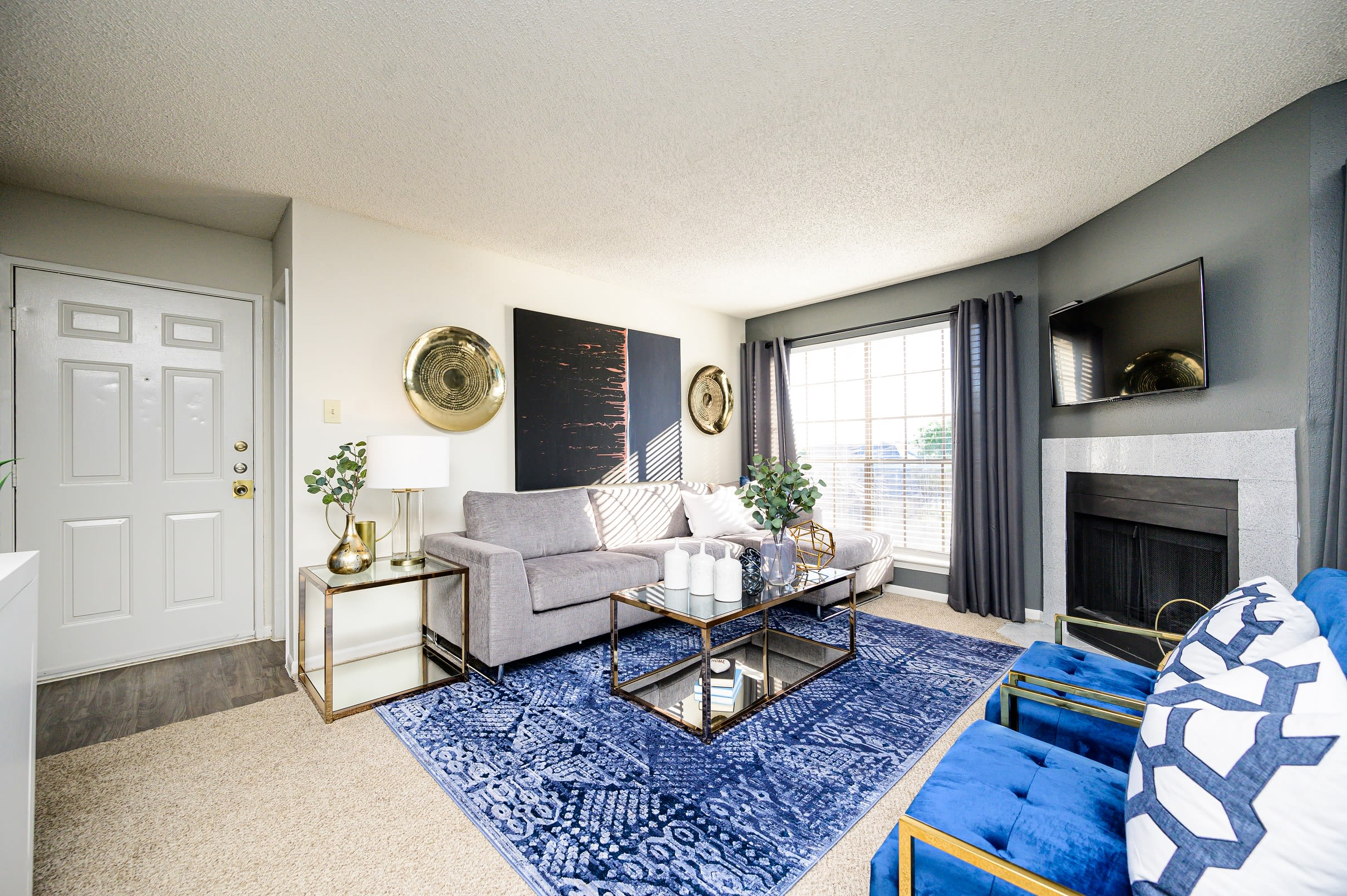 Living room with porch access at Laurel Heights at Cityview in Fort Worth, Texas