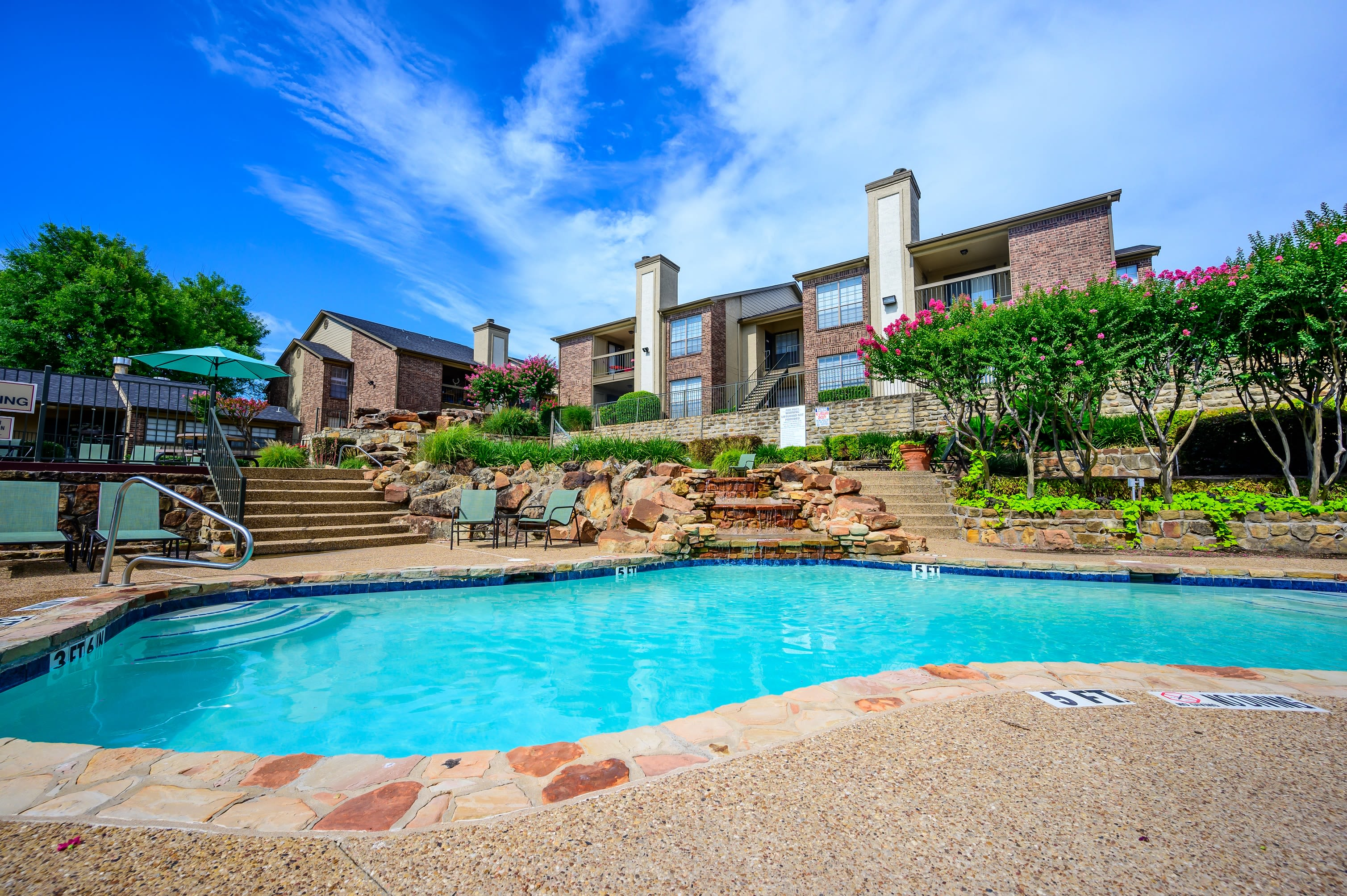 Resort-style pool with a spacious sundeck at Laurel Heights at Cityview in Fort Worth, Texas