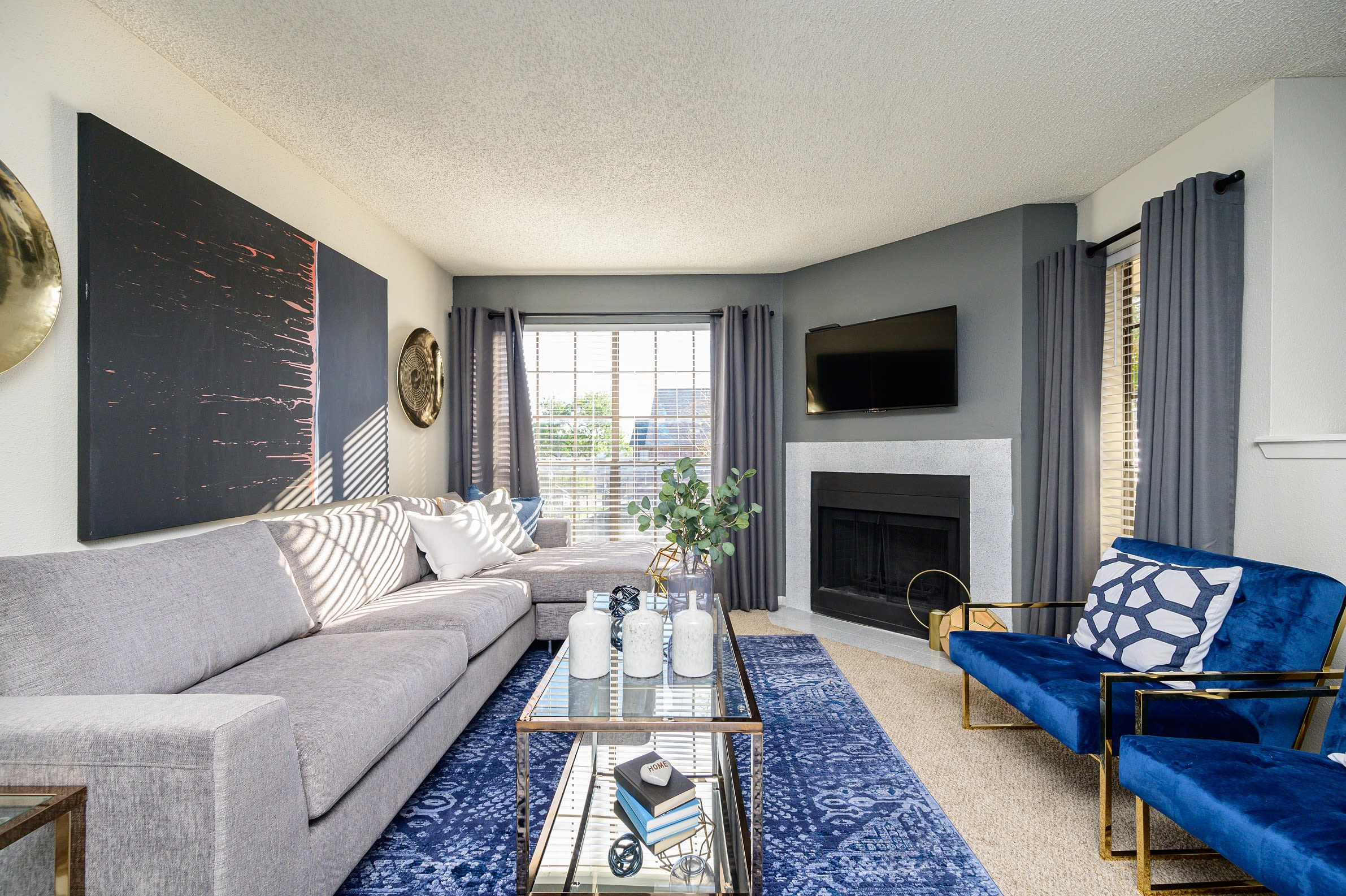 Living room with fireplace at Laurel Heights at Cityview in Fort Worth, Texas