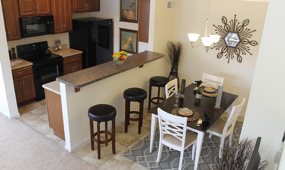 Kitchen and dining area at The Encore at Laurel Ridge in Harrisburg, Pennsylvania