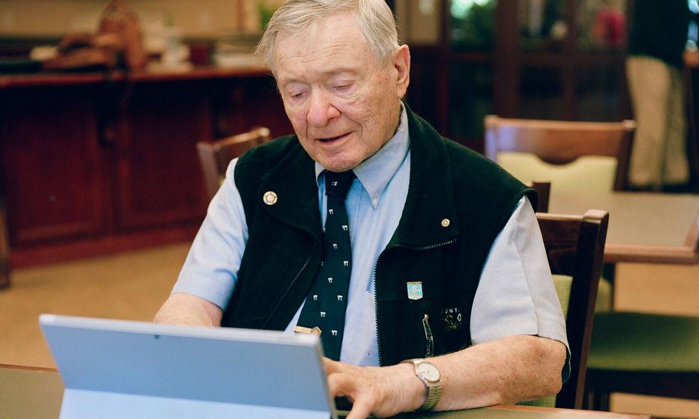 Senior Living resident using a computer at Merrill Gardens at Rolling Hills Estates in Rolling Hills Estates, California