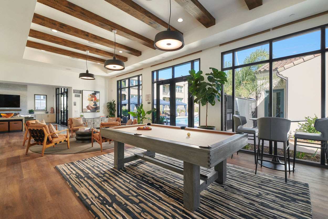 Clubhouse community space with billiards table at The Trails at Canyon Crest indoor fitness facility in Riverside, California