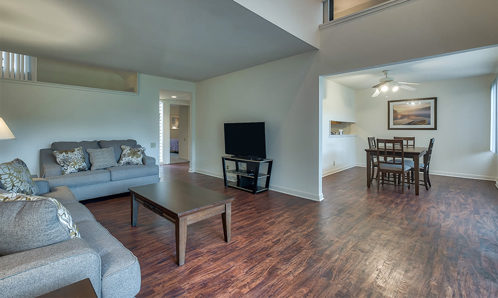 A living room that is great for entertaining at Emerald Springs Apartments in Painted Post, New York