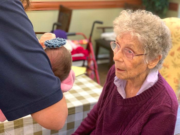 babies visiting memory care