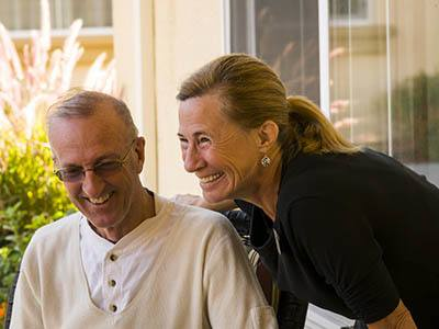 Residents laughing together at San Jose Gardens Alzheimer's Special Care Center in Jacksonville, Florida