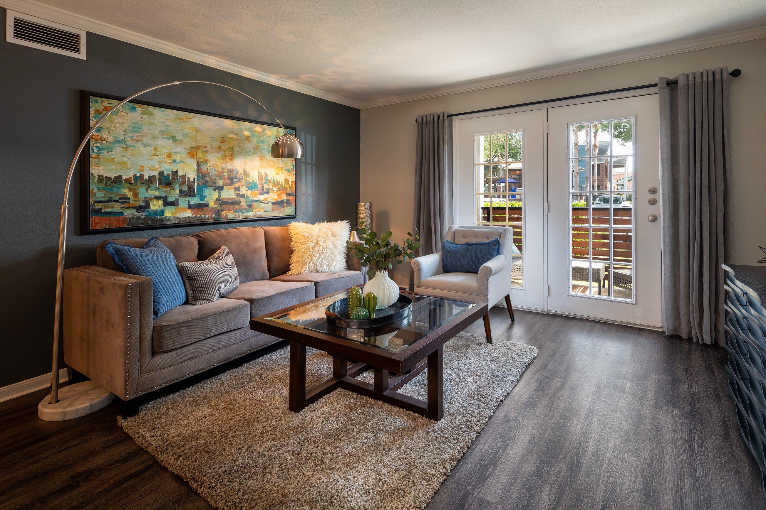 Well decorated living room with back porch access at Hayden at Enclave in Houston, Texas