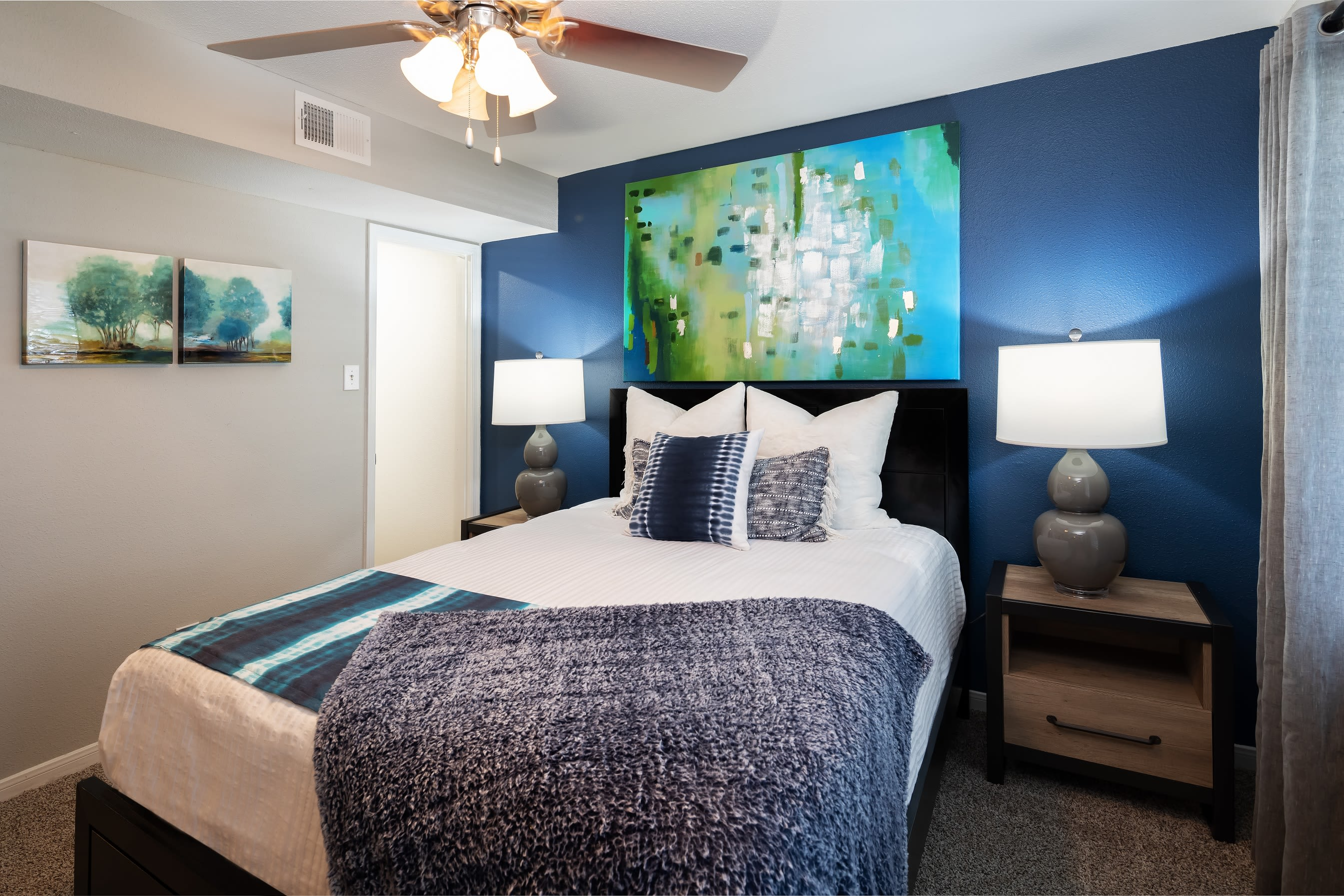 Guest bedroom with ceiling fan at Hayden at Enclave in Houston, Texas