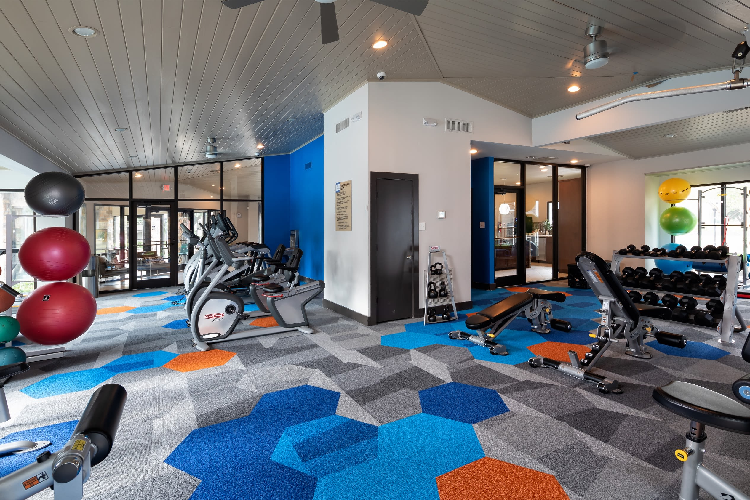 Large fitness center at Hayden at Enclave in Houston, Texas