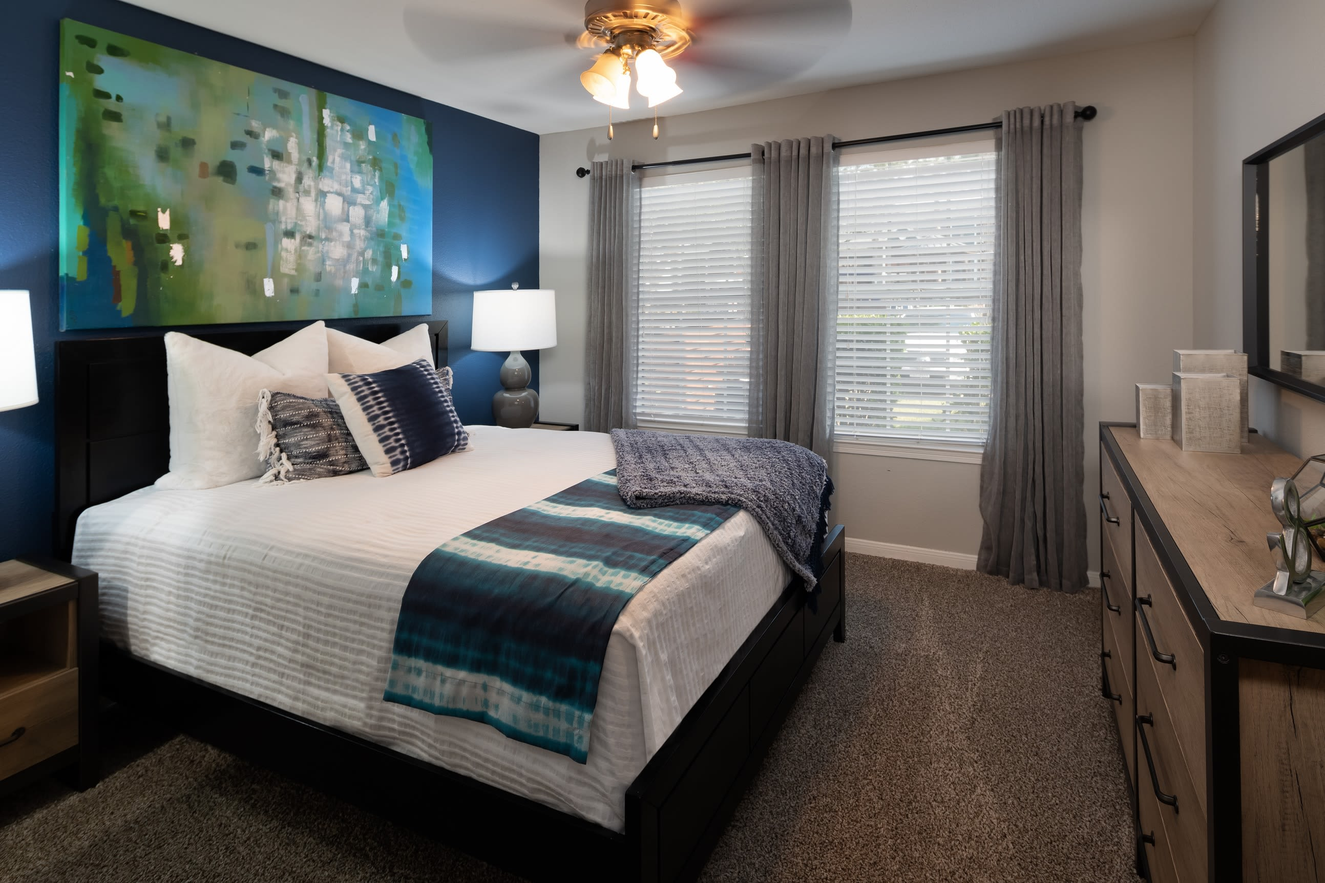 Model bedroom with ceiling fan at Hayden at Enclave in Houston, Texas