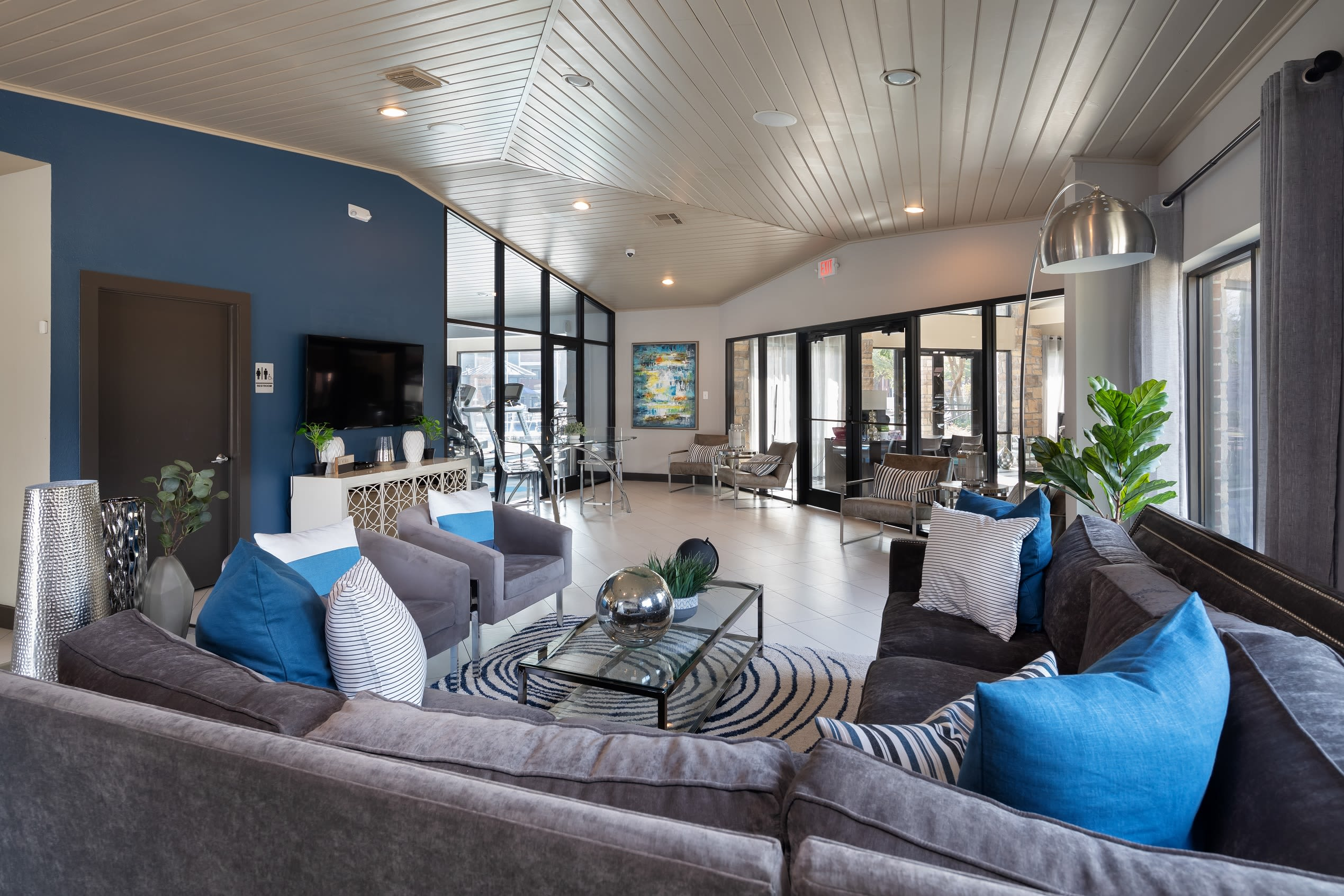 Large clubhouse seating area with TV at Hayden at Enclave in Houston, Texas