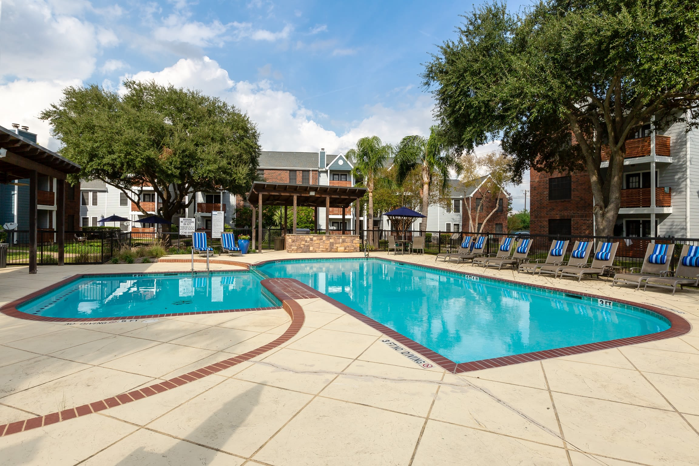 View of outdoor pool at Hayden at Enclave in Houston, Texas