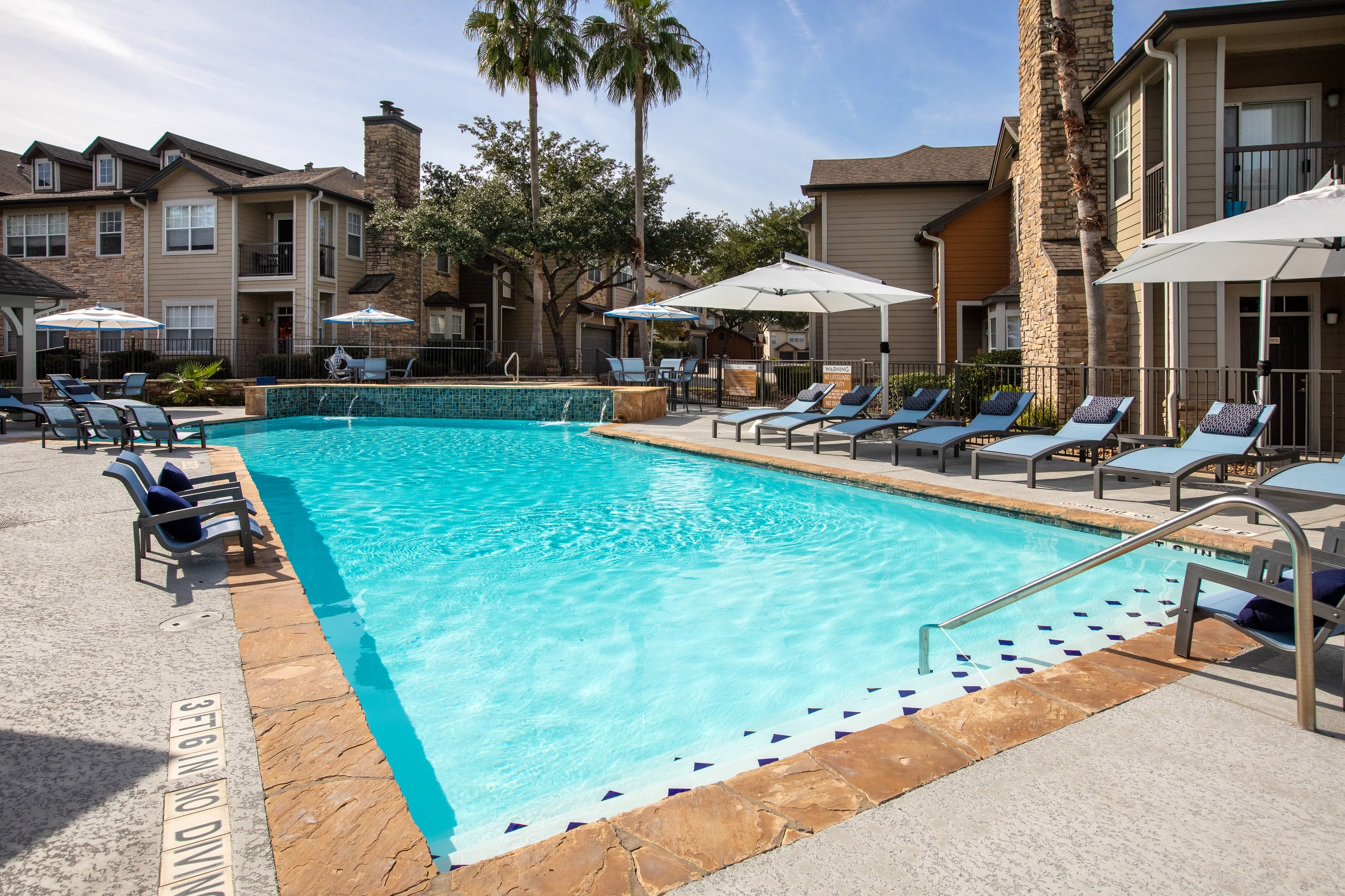 Heated and inviting outdoor pool at Artisan at Lake Wyndemere in The Woodlands, Texas