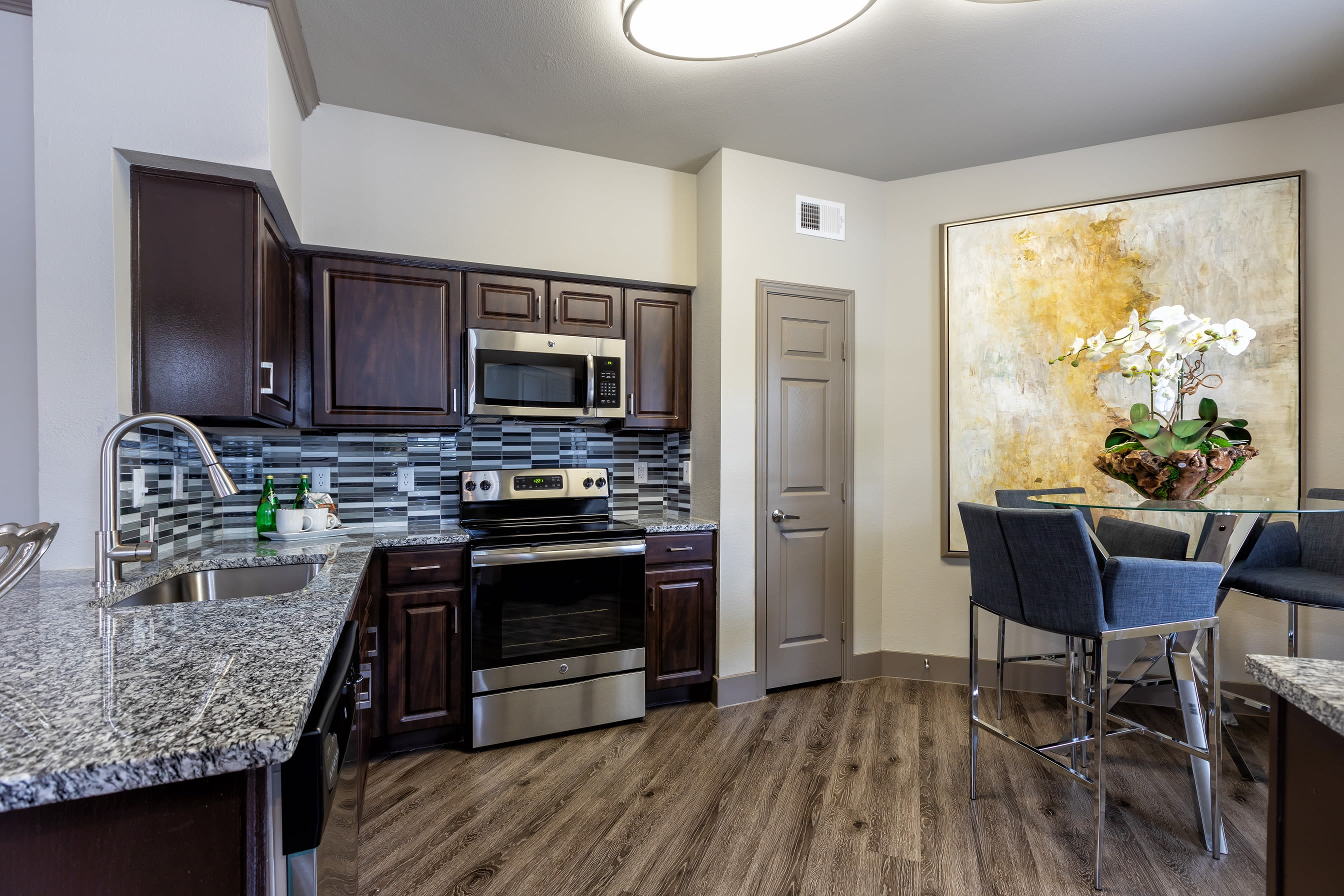 Open-concept layout with hardwood floors at Artisan at Lake Wyndemere in The Woodlands, Texas