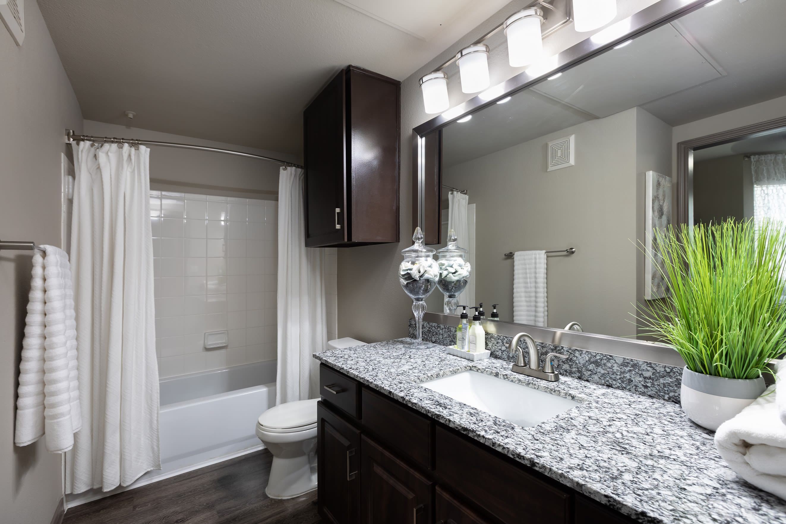 Spacious bathroom with tub and granite countertops at Artisan at Lake Wyndemere in The Woodlands, Texas