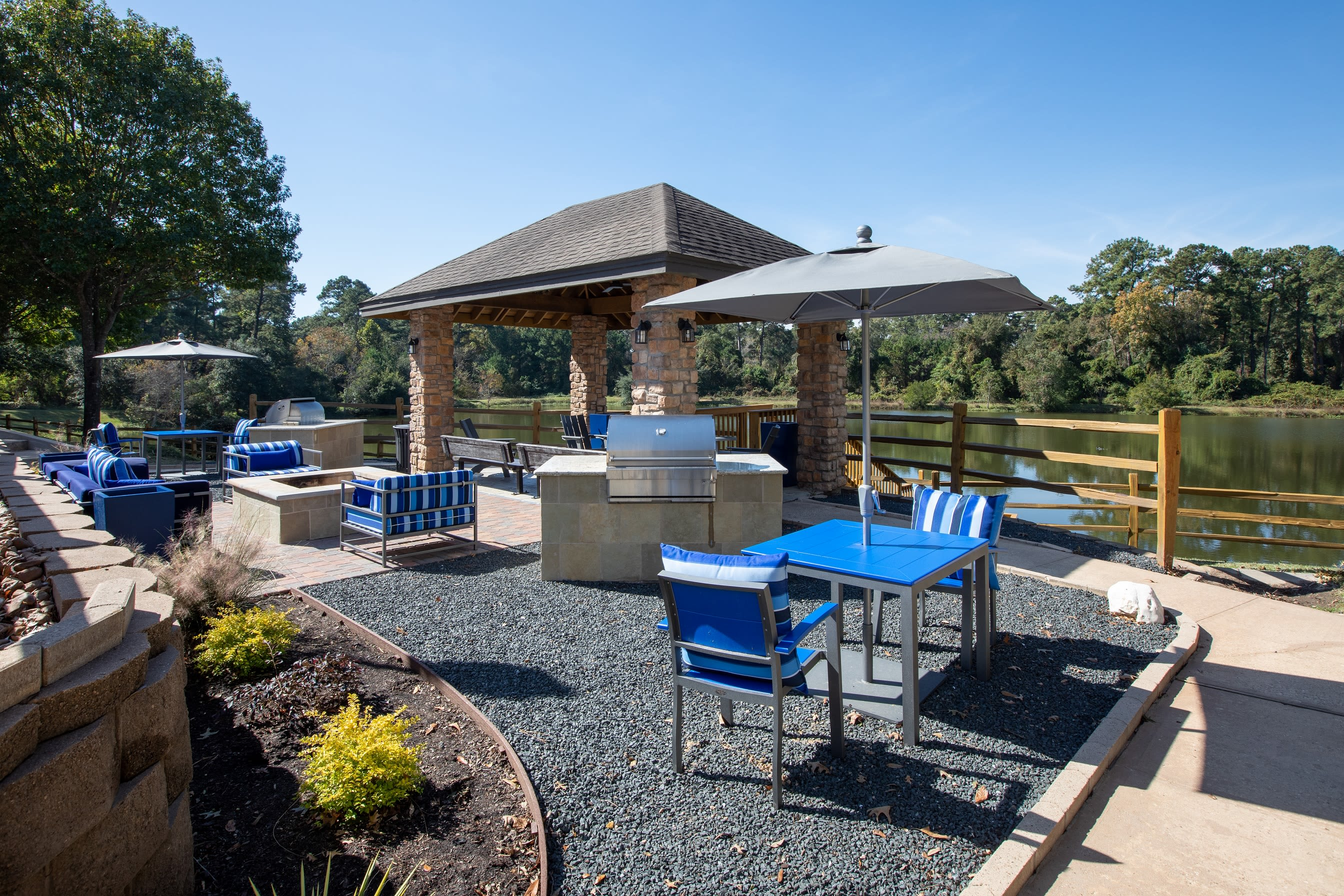 Gazebo with grilling area and outdoor seating for residents at Artisan at Lake Wyndemere in The Woodlands, Texas