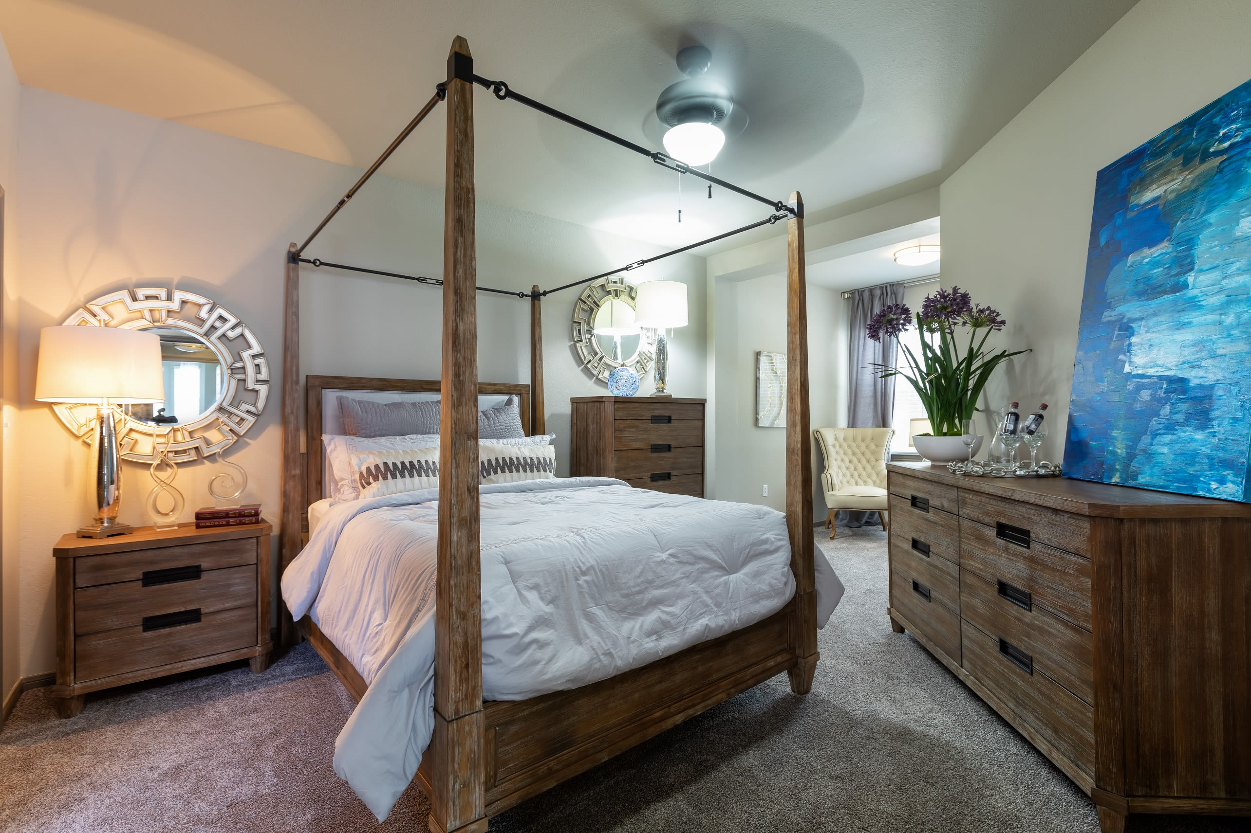 Very large main bedroom with wooden furnishings at Artisan at Lake Wyndemere in The Woodlands, Texas