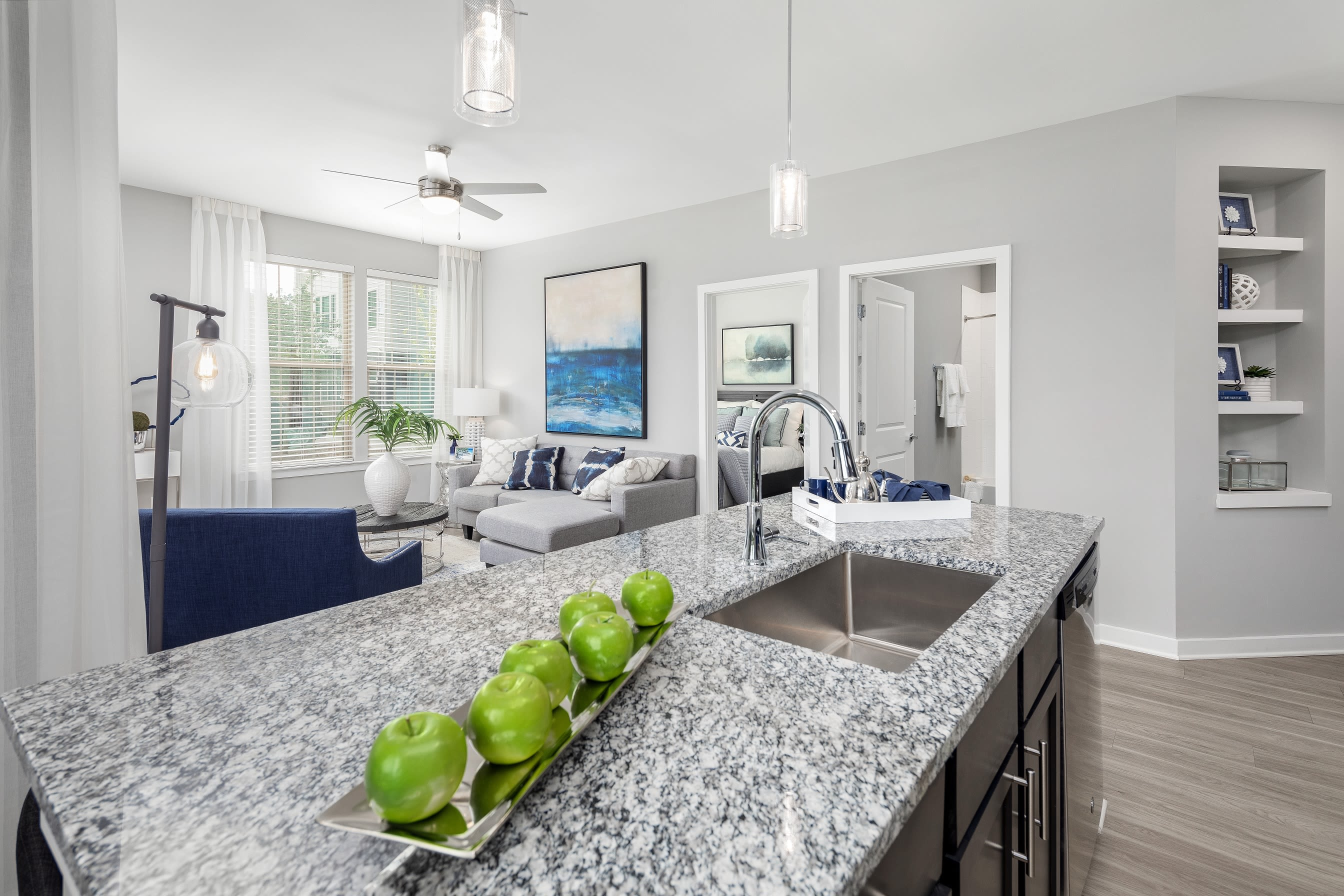 Open concept floor plan with granite countertop kitchen at Elevate at Brighton Park in Summerville, South Carolina