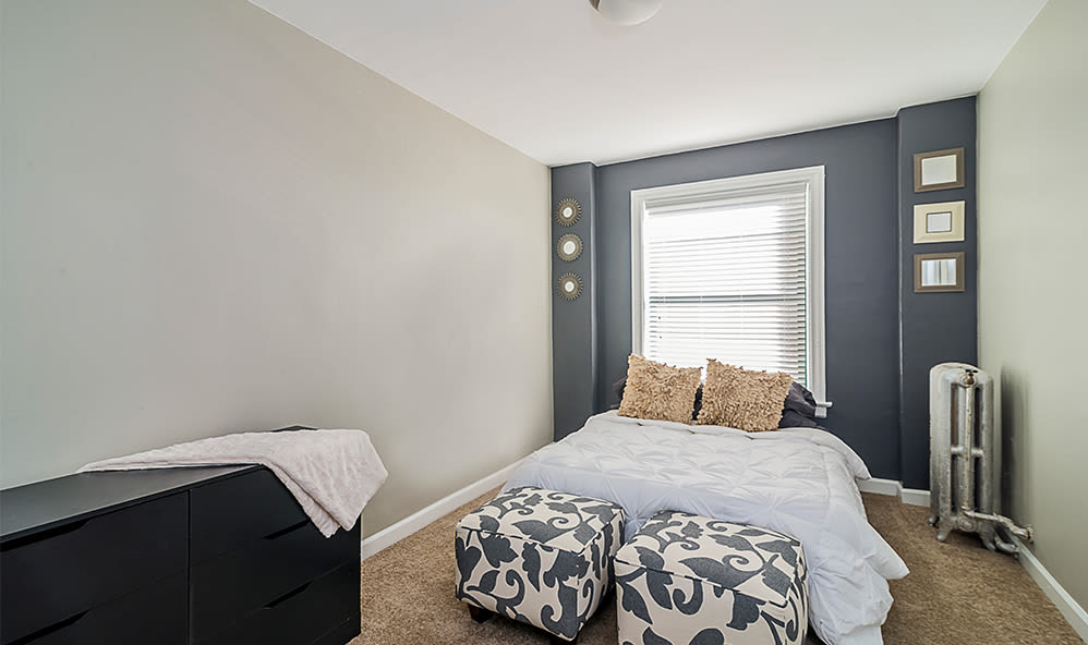 Comfortable bedroom at 7100 South Shore Apartment Homes in Chicago, Illinois