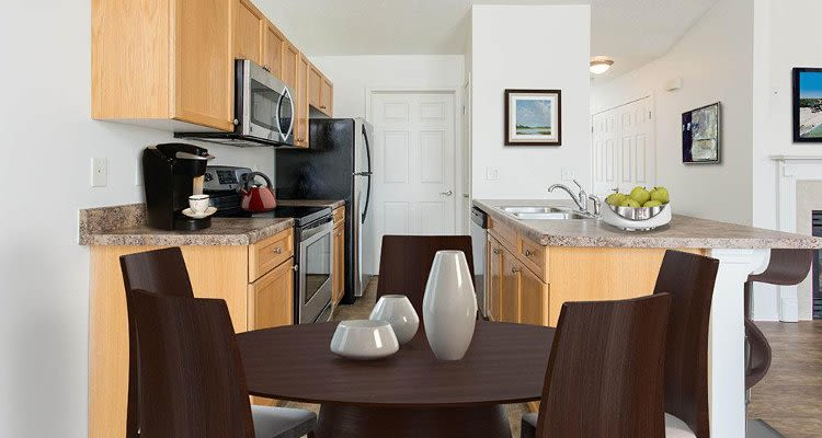 Upgraded kitchen and dining room view at Avon Commons in Avon, New York
