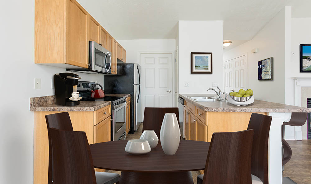 Dining room table and kitchen at Avon Commons in Avon, New York