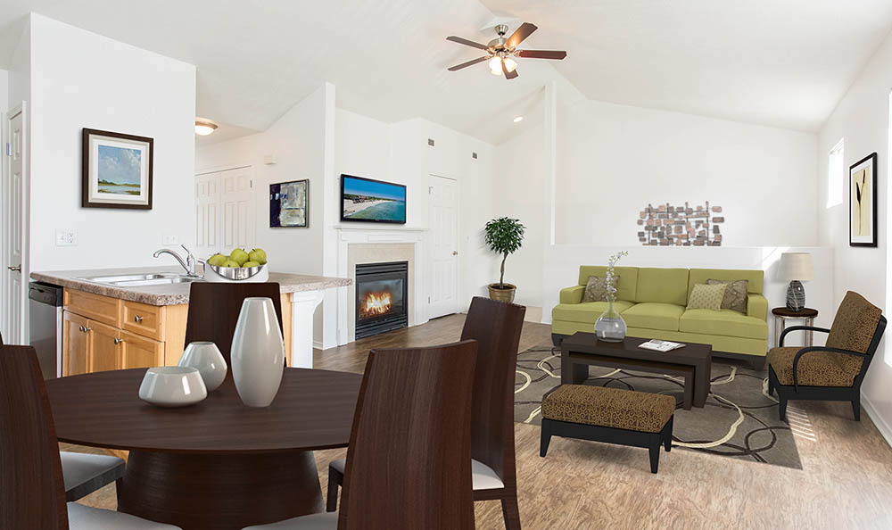 Living room with a ceiling fan at Avon Commons in Avon, New York