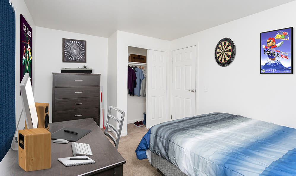 Well lit bedroom at Brockport Crossings Apartments & Townhomes in Brockport, New York