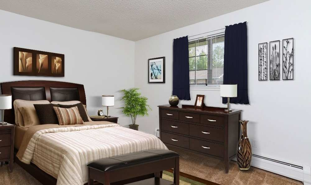 Well decorated bedroom at Creek Hill Apartments in Webster, New York
