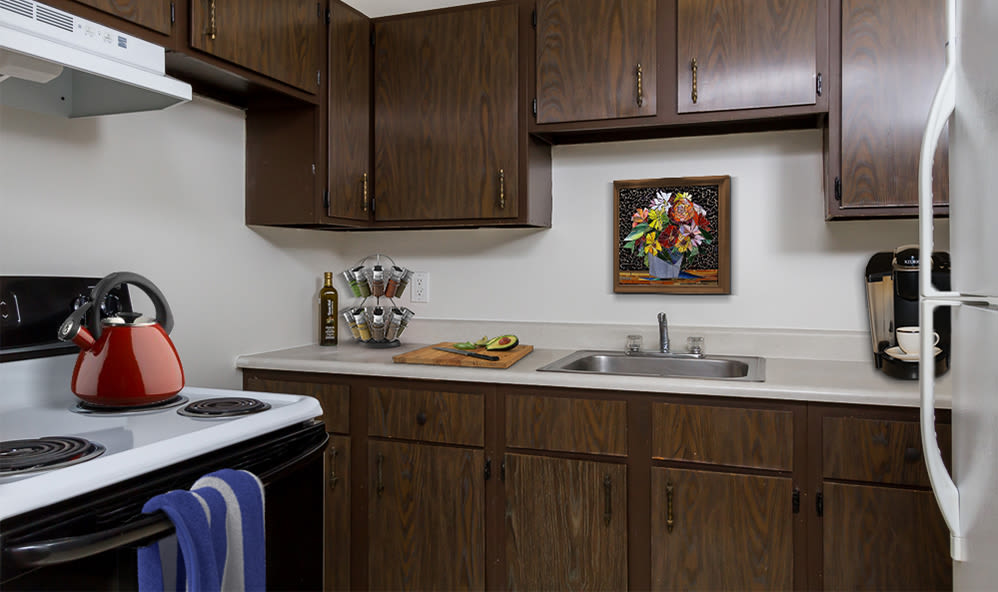 Kitchen with plenty of cabinet space at Creek Hill Apartments in Webster, New York