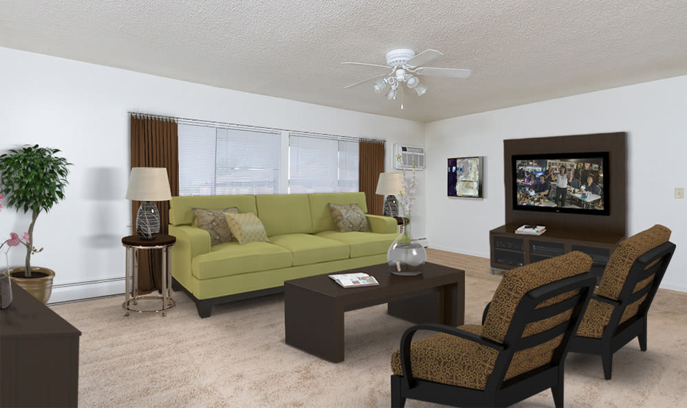 Bright, spacious living room at Creek Hill Apartments in Webster, New York