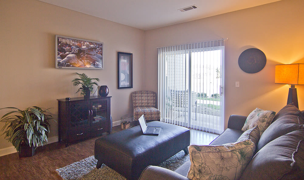 Spacious living room with patio access at Crescent at Wolfchase in Memphis, Tennessee