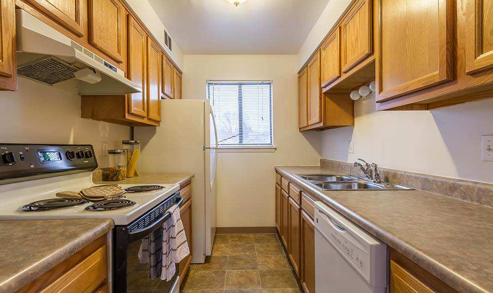 Well-equipped kitchen at Crossroads Apartments in Spencerport, New York