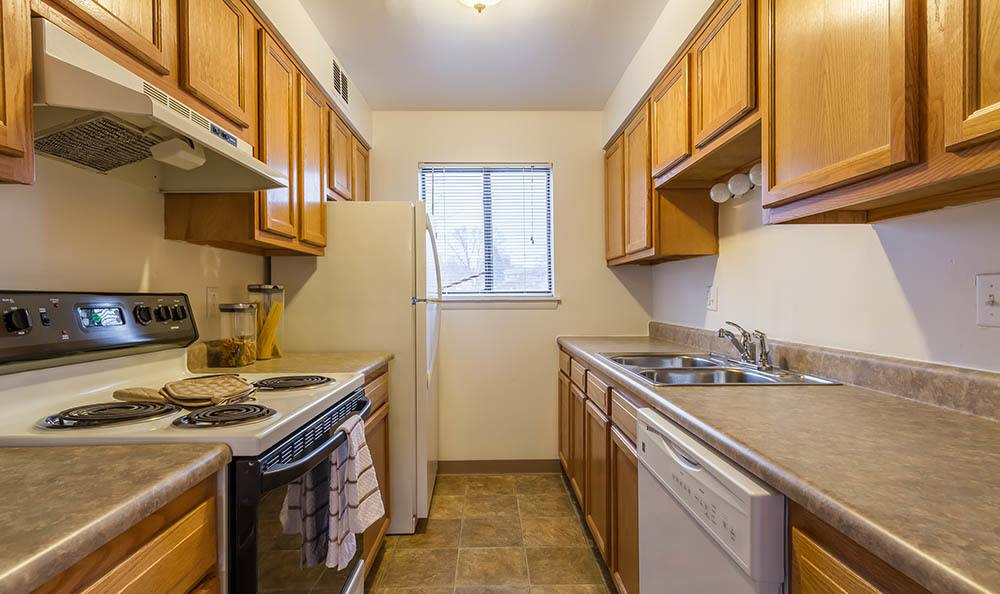 Fully-equipped kitchen at Crossroads Apartments in Spencerport, New York