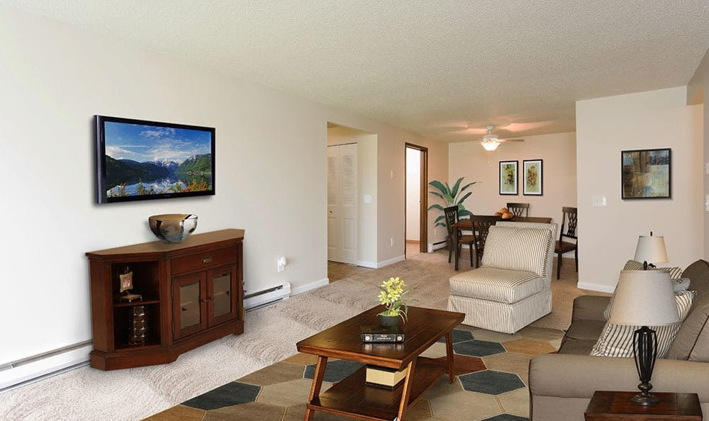 Bright living room at Crossroads Apartments in Spencerport, New York