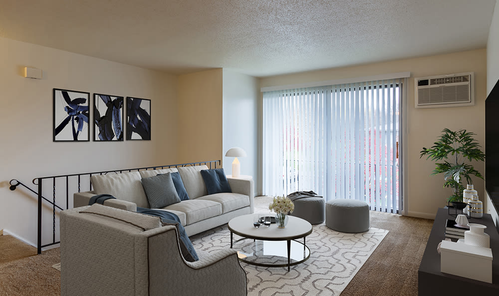 Naturally well-lit living room at Crossroads Apartments in Spencerport, New York