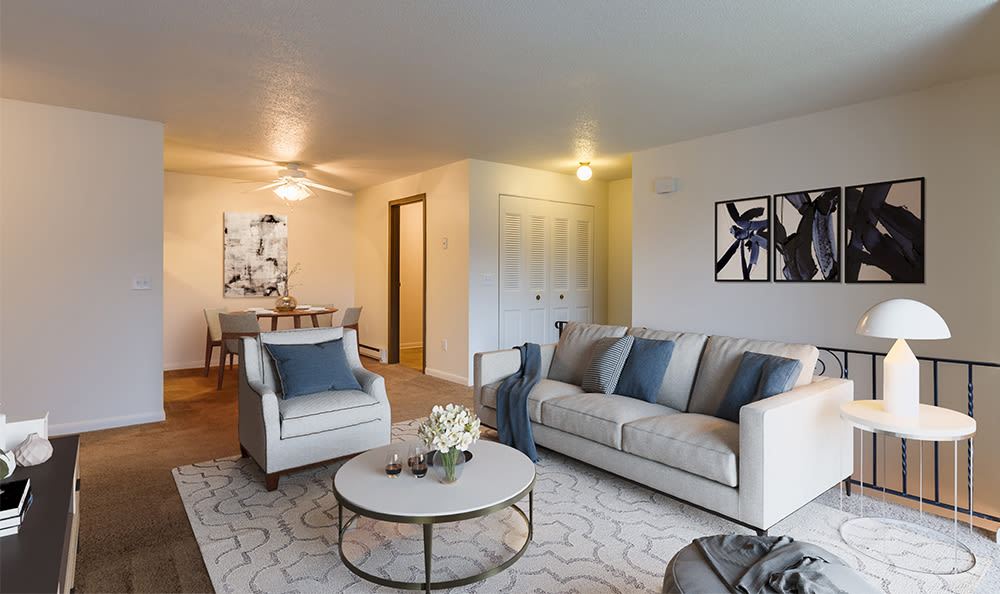 A living room that is great for entertaining at Crossroads Apartments in Spencerport, New York
