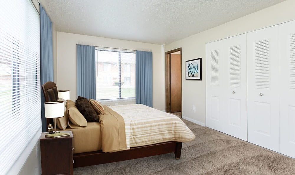 Cozy bedroom at Crossroads Apartments in Spencerport, New York